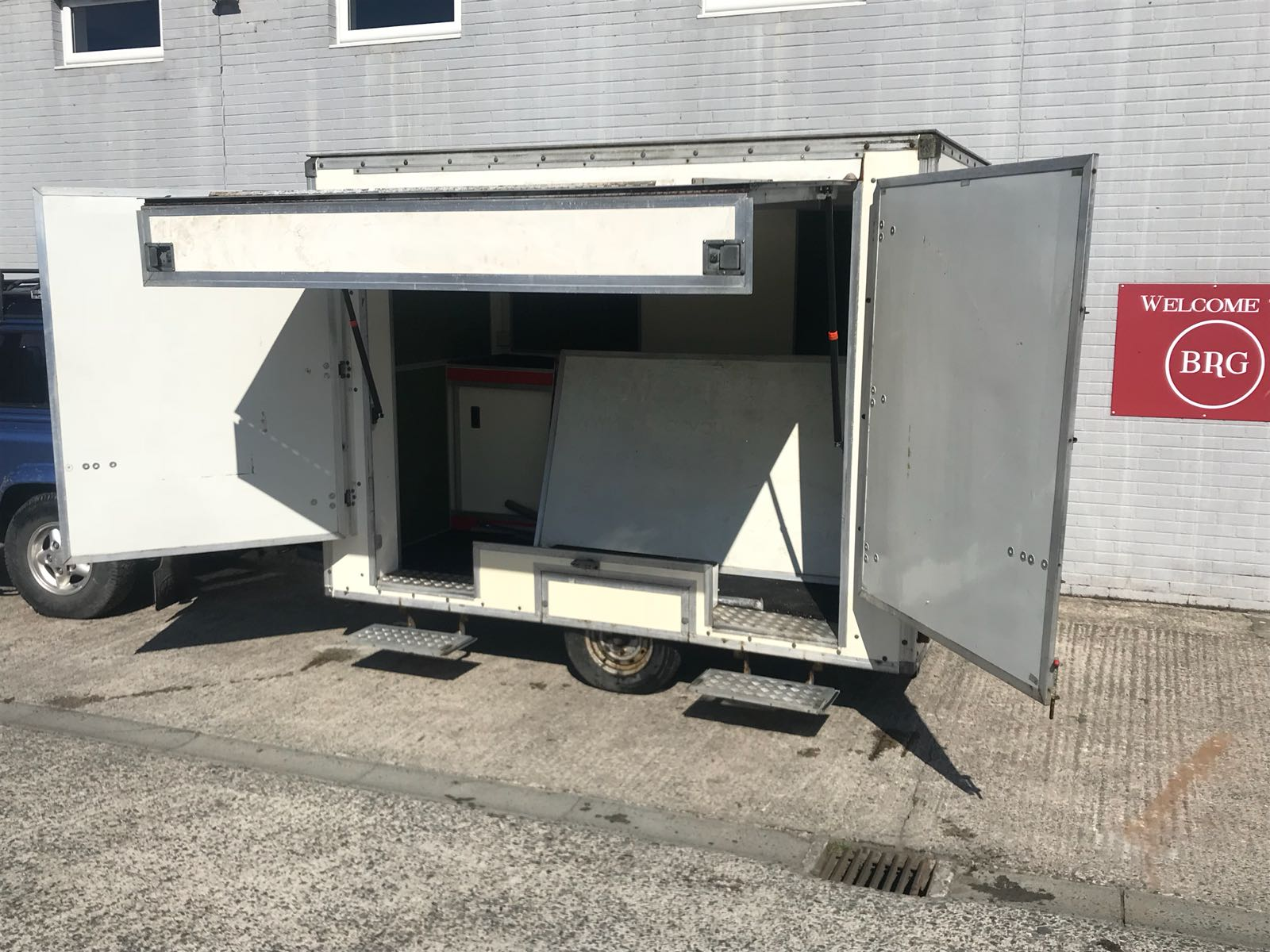 Advertising Corporate Hospitality Trailer 6x10 with fold out awning roof sign and steps